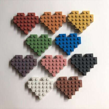 A rainbow of studded, 8-bit hearts