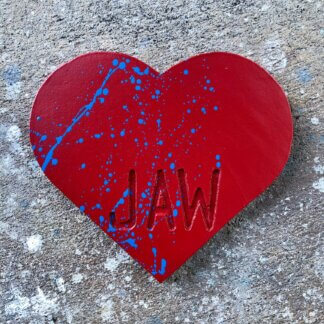 Red heart with blue splatters