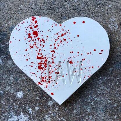 White heart with red splatter